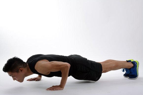 a man doing push ups