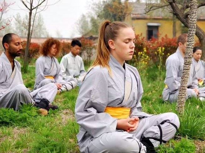Kung Fu trainees in meditation