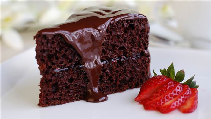 A slice of moist and decadent chocolate cake