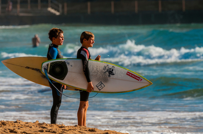 Young surfers having fun at a beach