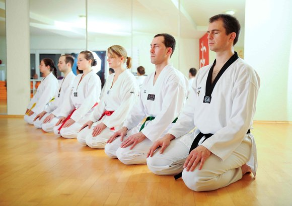 Taekwondo practitioners in meditation