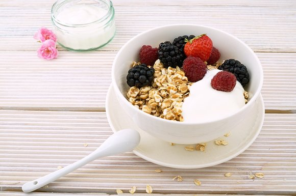 a bowl of oats with berries