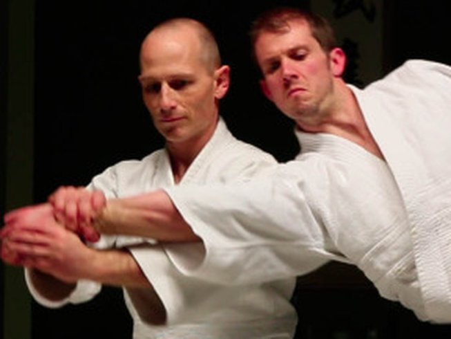An Aikido practitioner demonstrates the arm twist that can be effective in neutralizing an opponet