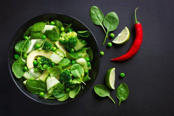 a bowl of an avocado & broccoli salad
