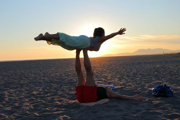 sunset partner yoga