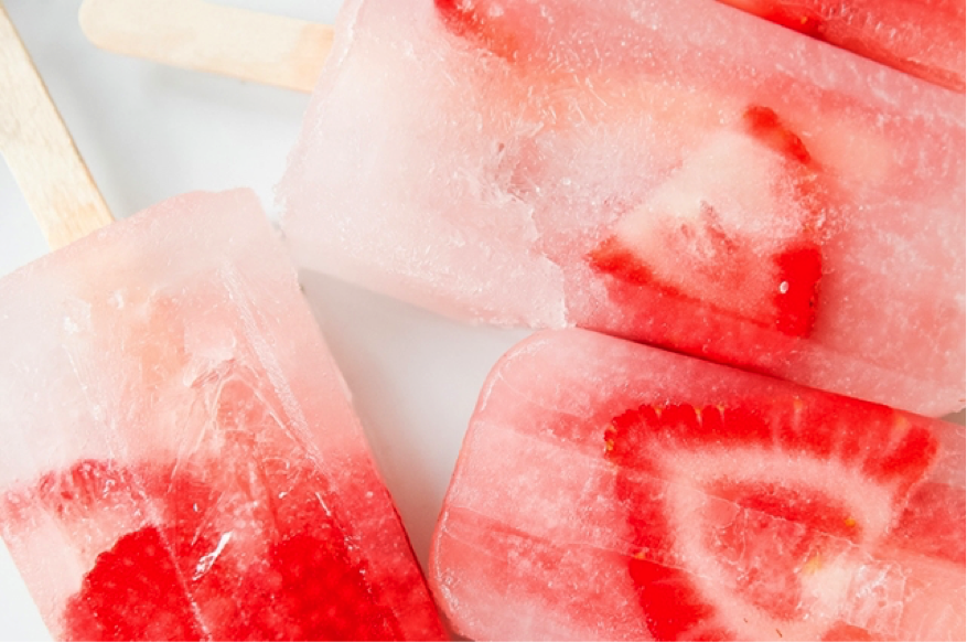 A couple of coconut water & pink lemonade popsicles